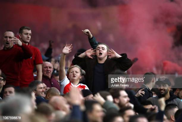 Arsenal fans celebrate during the Premier League match between Arsenal FC and Tottenham Hotspur at Emirates Stadium on December 1, 2018 in London,...