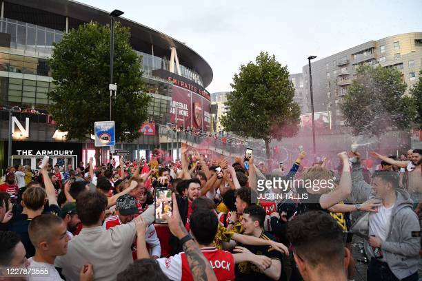 Arsenal fans celebrate outside the Emirates stadium in north London on August 1 after their team won the English FA Cup final football match against...