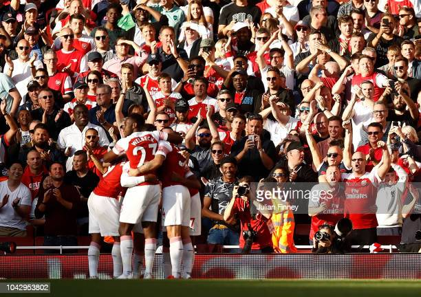 Arsenal fans celebrate their teams first goal scored by Alexandre Lacazette of Arsenal during the Premier League match between Arsenal FC and Watford...