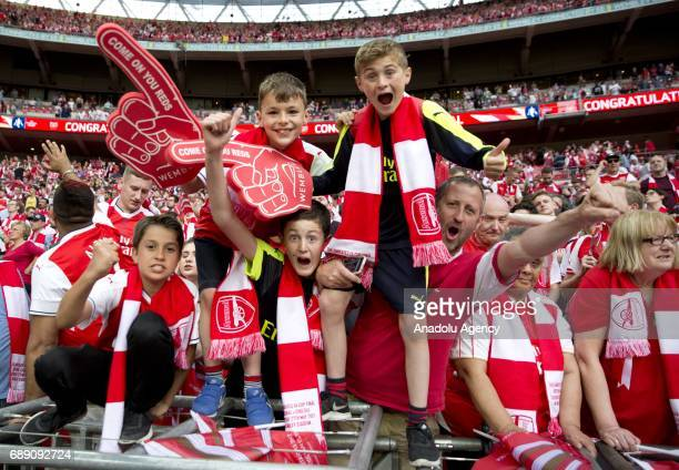 Arsenal fans celebrate their team's victory against Chelsea FC in the FA Cup final at Wembley Stadium on May 27 2017 in London United Kingdom