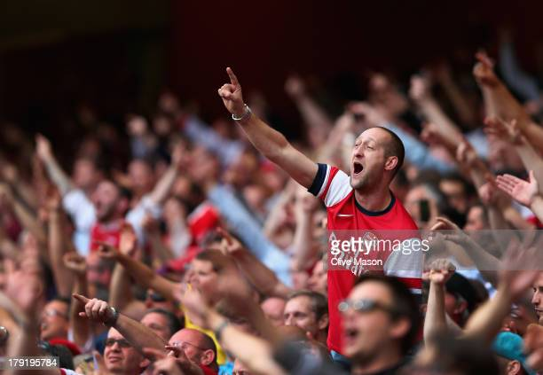Arsenal fans celebrate victory after the Barclays Premier League match between Arsenal and Tottenham Hotspur at Emirates Stadium on September 01,...