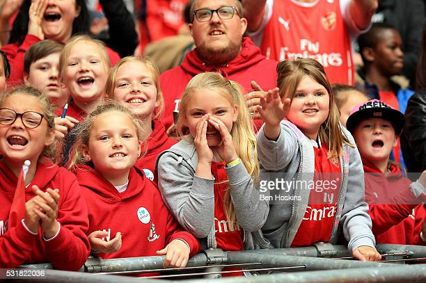 Arsenal fans cheer on their team during the SSE Women's FA Cup Final between Arsenal Ladies and Chelsea Ladies at Wembley Stadium on May 14 2016 in...