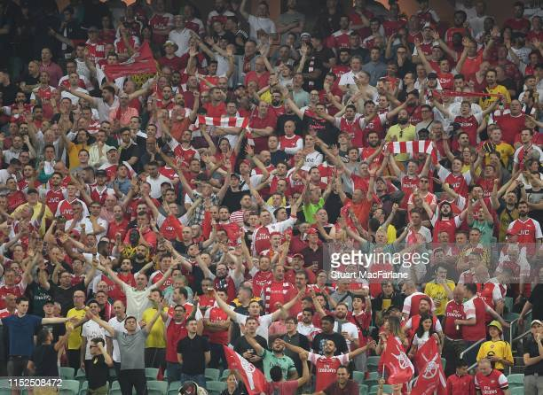 Arsenal fans cheer their team during the UEFA Europa League Final between Chelsea and Arsenal at Baku Olimpiya Stadionu on May 29 2019 in Baku...