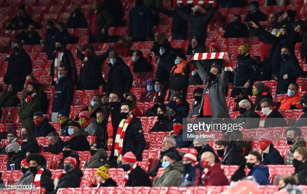 Arsenal fans cheer there team from the stands after the UEFA Europa League Group B stage match between Arsenal FC and Rapid Wien at Emirates Stadium...