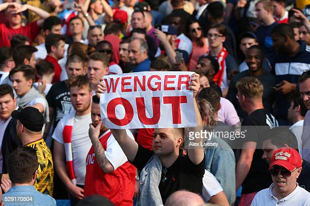 Arsenal fans display 'Wenger Out' banners following the Barclays Premier League match between Manchester City and Arsenal at the Etihad Stadium on...