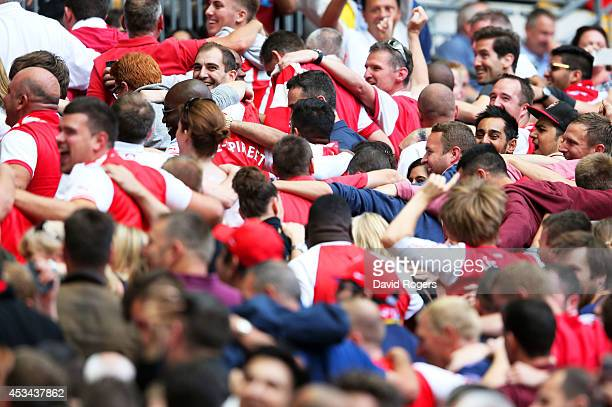 Arsenal fans do the Poznan dance in celebration during the FA Community Shield match between Manchester City and Arsenal at Wembley Stadium on August...