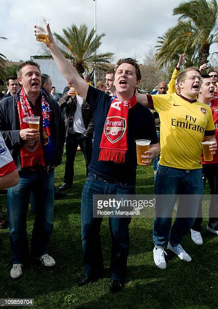 Arsenal fans gather at the Arsenal fan meeting point at the Olympic Village before the UEFA Champions League round of 16 second leg match between...