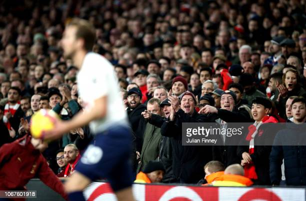 Arsenal fans gesture towards Harry Kane of Tottenham Hotspur during the Premier League match between Arsenal FC and Tottenham Hotspur at Emirates...