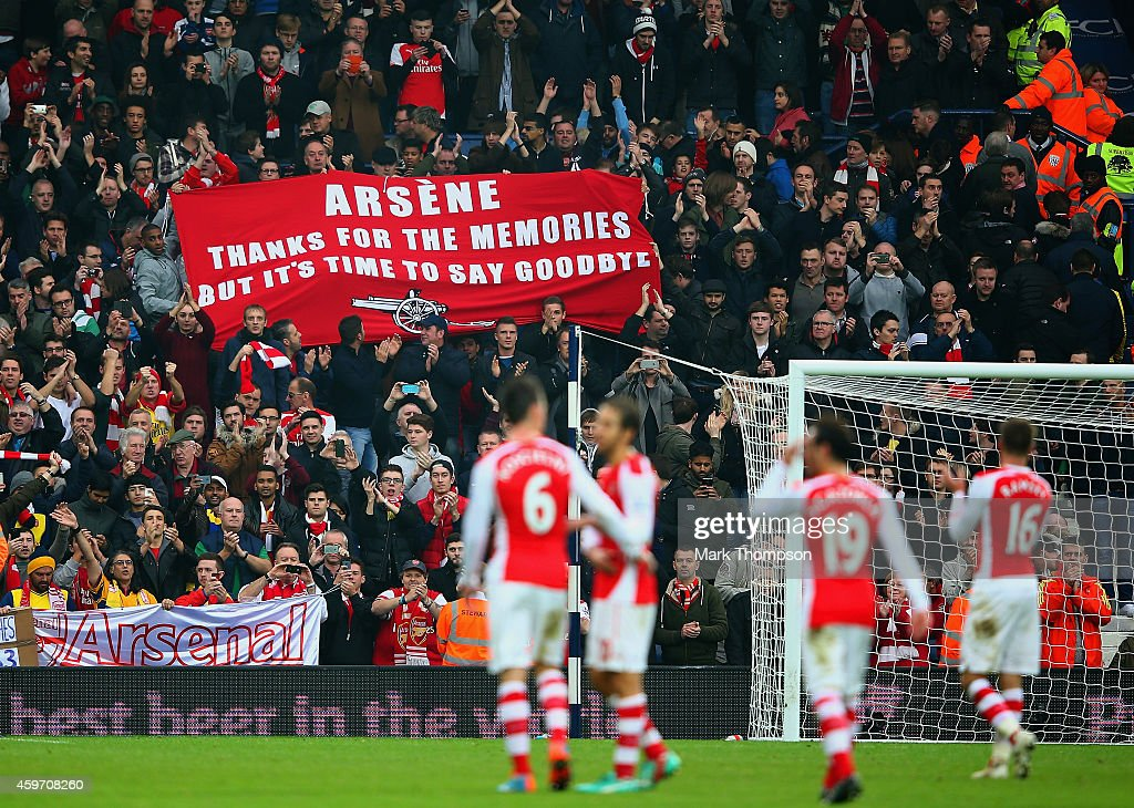 Arsenal fans hold up a banner for Arsene Wenger, manager of Arsenal during the Barclays Premier League match between West Bromwich Albion and Arsenal at The Hawthorns on November 29, 2014 in West Bromwich, England
