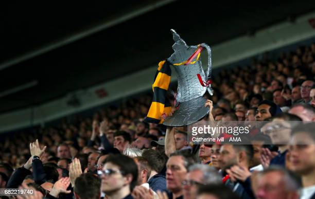 Arsenal fans hold up a home made foil FA Cup trophy during the Premier League match between Southampton and Arsenal at St Mary's Stadium on May 10...