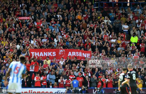 Arsenal fans hold up Arsene Wenger banners during the Premier League match between Huddersfield Town and Arsenal at John Smith's Stadium on May 13...