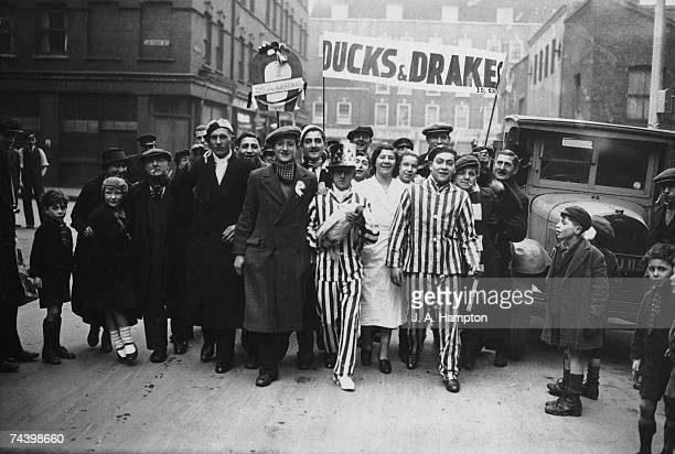 Arsenal fans holding their duck mascot leaving London to travel to Reading for the FA Cup tie 16th February 1935