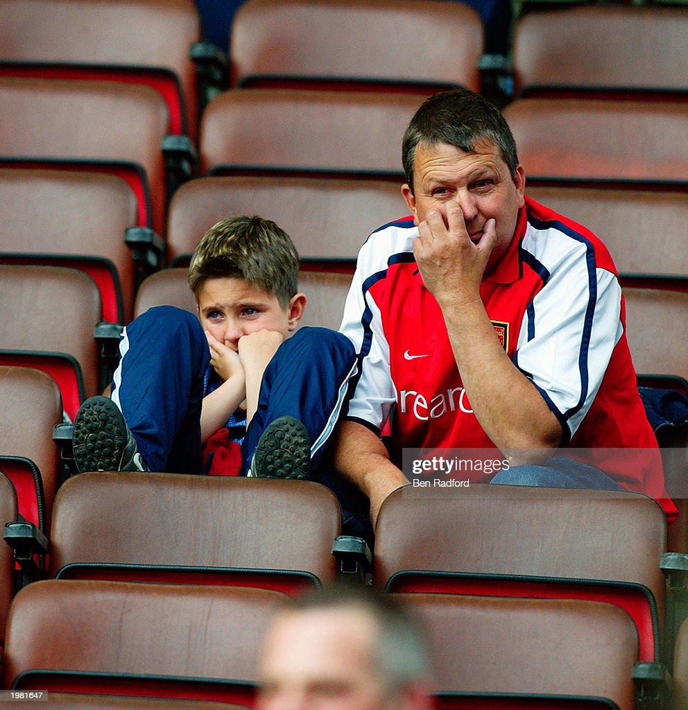 Arsenal fans look dejected after losing a match and title that seemed to be heading to them not to long ago : News Photo