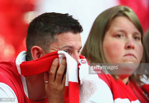 Arsenal fans look dejected after the FA Cup sponsored by EON Semi Final match between Arsenal and Chelsea at Wembley Stadium on April 18 2009 in...