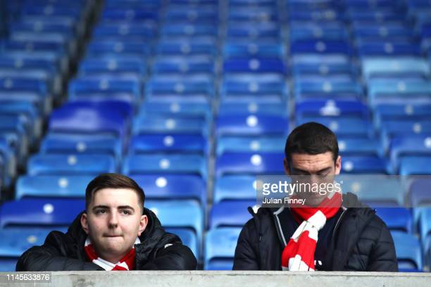 Arsenal fans look dejected after the Premier League match between Leicester City and Arsenal FC at The King Power Stadium on April 28 2019 in...