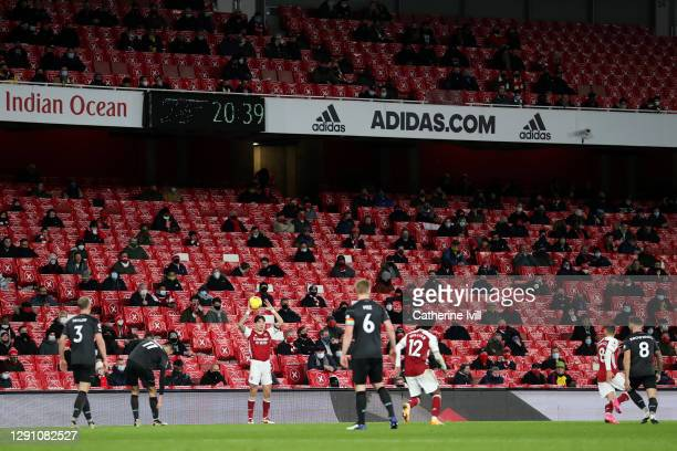 Arsenal fans look on as Hector Bellerin of Arsenal takes a throw in during the Premier League match between Arsenal and Burnley at Emirates Stadium...