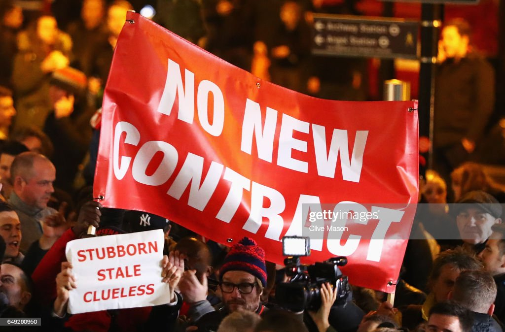 Arsenal fans march in protest outside the stadium prior to the UEFA Champions League Round of 16 second leg match between Arsenal FC and FC Bayern Muenchen at Emirates Stadium on March 7, 2017 in London, United Kingdom.