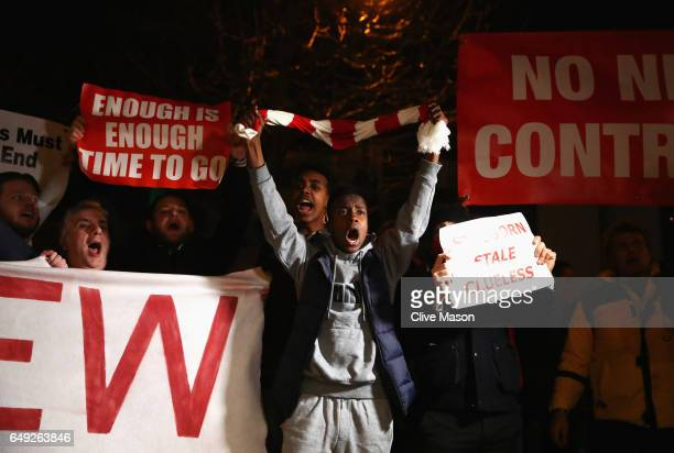 Arsenal fans march in protest outside the stadium prior to the UEFA Champions League Round of 16 second leg match between Arsenal FC and FC Bayern...
