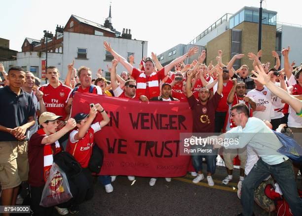 Arsenal fans participate in a planned rally in support of their manager Arsene Wenger before the Barclays Premier League match between Arsenal and...