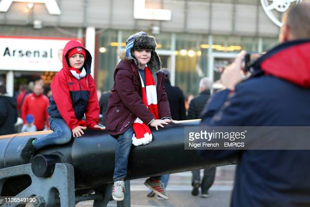 Arsenal fans pose for a photograph outside of the Emirates Stadium ahead of the match Arsenal v FC BATE Borisov UEFA Europa League Round of 32 Second...