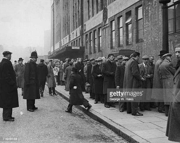 Arsenal fans queuing at the stadium box office, Highbury, for tickets to the 5th round F A Cup replay against Preston North End, 19th February 1957.