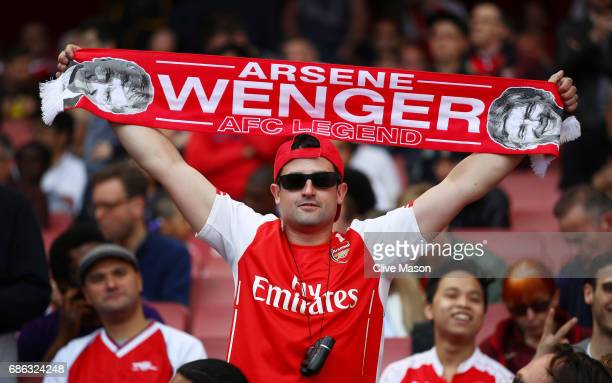 Arsenal fans show their support during the Premier League match between Arsenal and Everton at Emirates Stadium on May 21 2017 in London England
