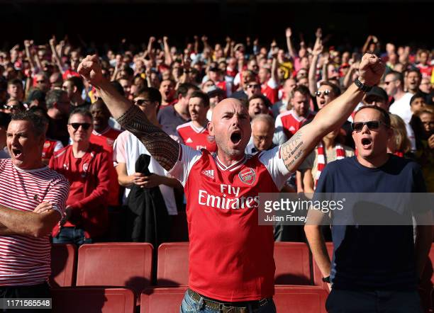 Arsenal fans show their support during the Premier League match between Arsenal FC and Tottenham Hotspur at Emirates Stadium on September 01, 2019 in...