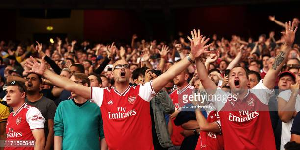 Arsenal fans show their support during the Premier League match between Arsenal FC and Tottenham Hotspur at Emirates Stadium on September 01 2019 in...