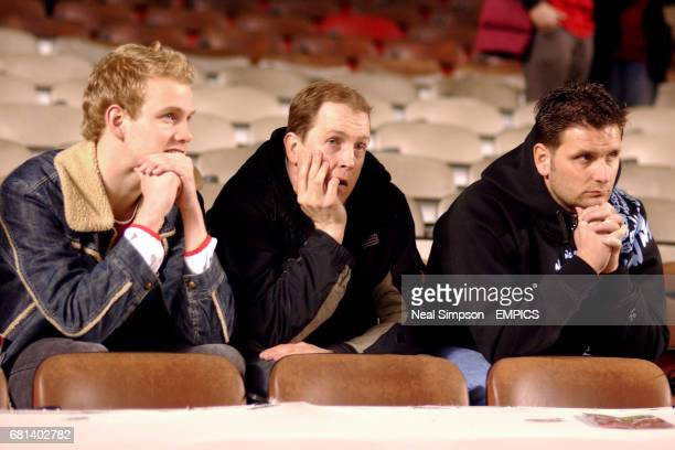 Arsenal fans sit dejected after their defeat against Chelsea