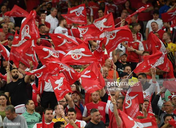 Arsenal fans wave flags before the UEFA Europa League Final between Chelsea and Arsenal at Baku Olimpiya Stadionu on May 29 2019 in Baku Azerbaijan