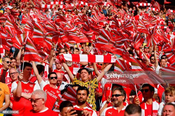 Arsenal fans wave flags during the English FA Cup final football match between Arsenal and Chelsea at Wembley stadium in London on May 27 2017 / NOT...