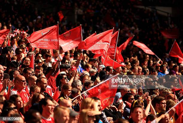Arsenal fans wave flags during the SSE Women's FA Cup Final between Arsenal Ladies and Chelsea Ladies at Wembley Stadium on May 14 2016 in London...