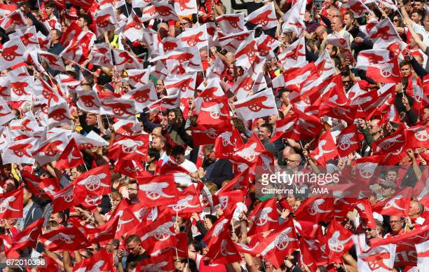 Arsenal fans with flags during the Emirates FA Cup semifinal match between Arsenal and Manchester City at Wembley Stadium on April 23 2017 in London...