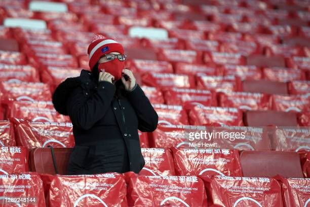 Arsenal FC fan is seen sitting in a socially distanced seat in the stands prior to the UEFA Europa League Group B stage match between Arsenal FC and...