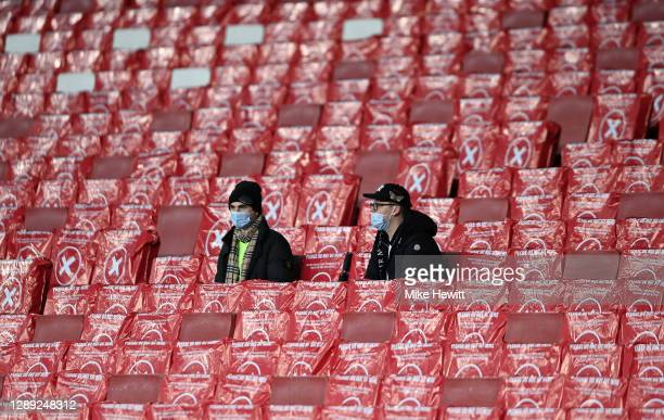 Arsenal FC fans are seen sitting in socially distanced seats prior to the UEFA Europa League Group B stage match between Arsenal FC and Rapid Wien at...