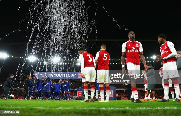 Arsenal FC look on as Chelsea FC lift the trophy after winning the FA Youth Cup Final second leg match between Arsenal and Chelsea at Emirates...