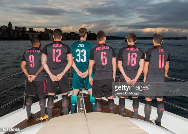 Arsenal FC players Laurent Koscielny Petr Cech Alexandre Lacazette Olivier Giroud Mesut Ozil and Nacho Monreal look out on Sydney Harbour en route to...