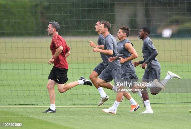 Arsenal fitness coach Shad Forsythe runs with Granit Xhaka Stephan Lichtsteiner Lucas Torreira and Ainsley MaitlandNiles during a training session at...