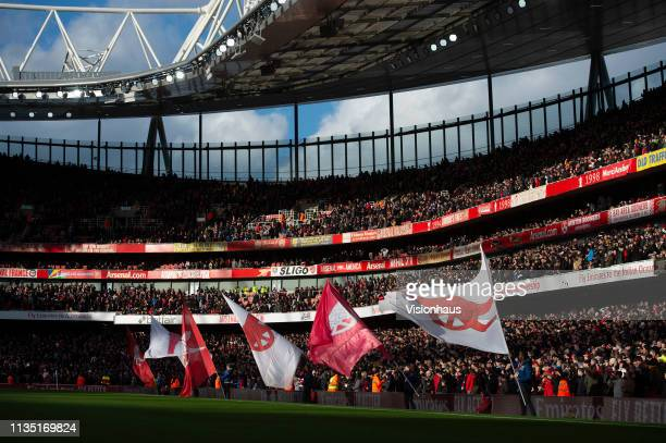 Arsenal flags being waved before the Premier League match between Arsenal FC and Manchester United at Emirates Stadium on March 10 2019 in London...