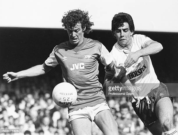 Arsenal Football Club defender Graham Rix is challenged by Tottenham Hotspur defender Gary Stevens during a First Division match at Highbury London...