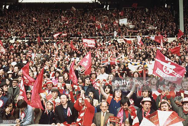 Arsenal Football Supporters waving flags at Wembley stadium during the 1972 Football Association Cup Final