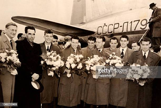 Arsenal football team are welcomed on their arrival at Vnukovo Airport in Moscow on 8th October 1954 Left to right Bob Wall Russian official David...