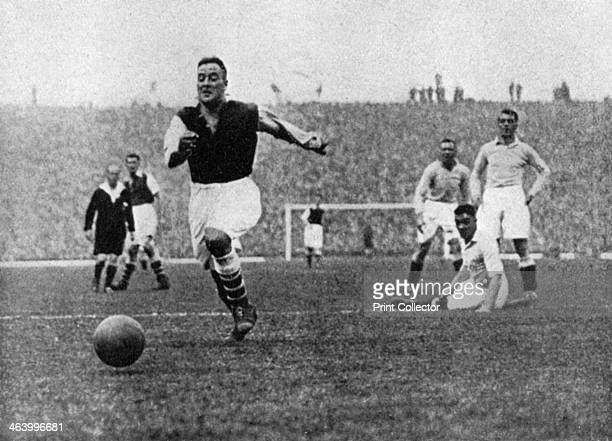 Arsenal footballer Alex James passes three Manchester City players, c1929-c1937. An inside forward renowned for his ball control and passing, Alex...