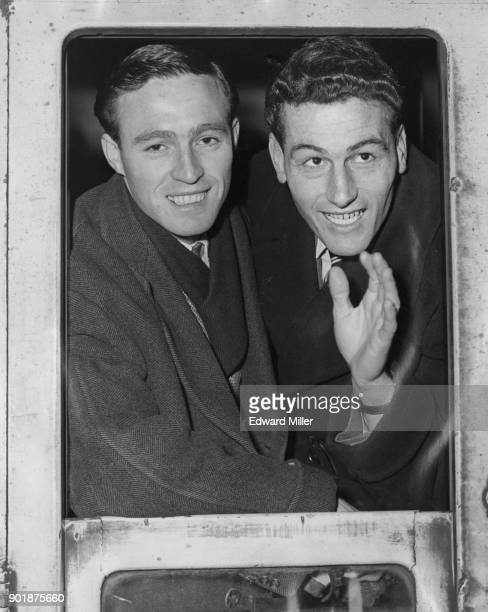 Arsenal footballer Jimmy Bloomfield and Arsenal captain Cliff Holton leave Euston Station in London for their cup tie match with Preston North End...