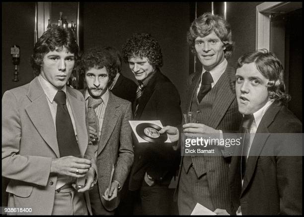 Arsenal footballers Frank Stapleton Alan Sunderland Willie Young and Richie Powling promoting the team's single 'Roll Out The Red Carpet' London 1978