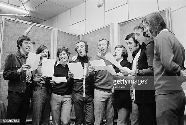 Arsenal footballers in a recording studio in London UK to record the single 'Good Old Arsenal' April 1971 They sang the song at the 1971 FA Cup Final...