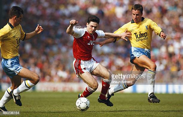 Arsenal forward Anders Limpar holds off the challenge of Crystal Palace defender Gareth Southgate during a league Division One match at Higbury on...