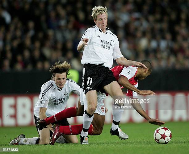Arsenal forward Thierry Henry of Arsenal is brought down by Frode Johnsen and Jan Gunnar Solli during The Champions League Group E game between...