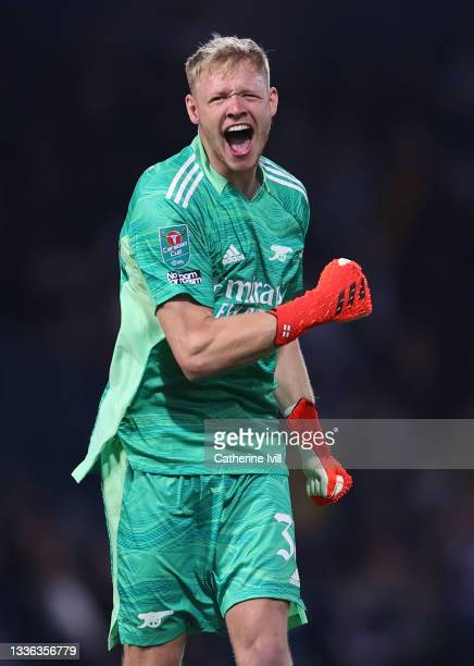 Arsenal goalkeeper Aaron Ramsdale celebrates the first goal during the Carabao Cup Second Round match between West Bromwich Albion and Arsenal at The...