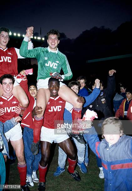 Arsenal goalkeeper Alan Miller sits on Kevin Campbell's shoulders as they celebrate victory over Doncaster Rovers in the FA Youth Cup Final 2nd leg...
